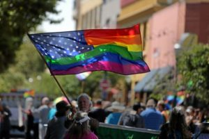 A rainbow flag is caught in the midday sun on Pacific Avenue in Santa Cruz on Sunday during the annual Pride Parade. (Kevin Johnson -- Santa Cruz Sentinel)